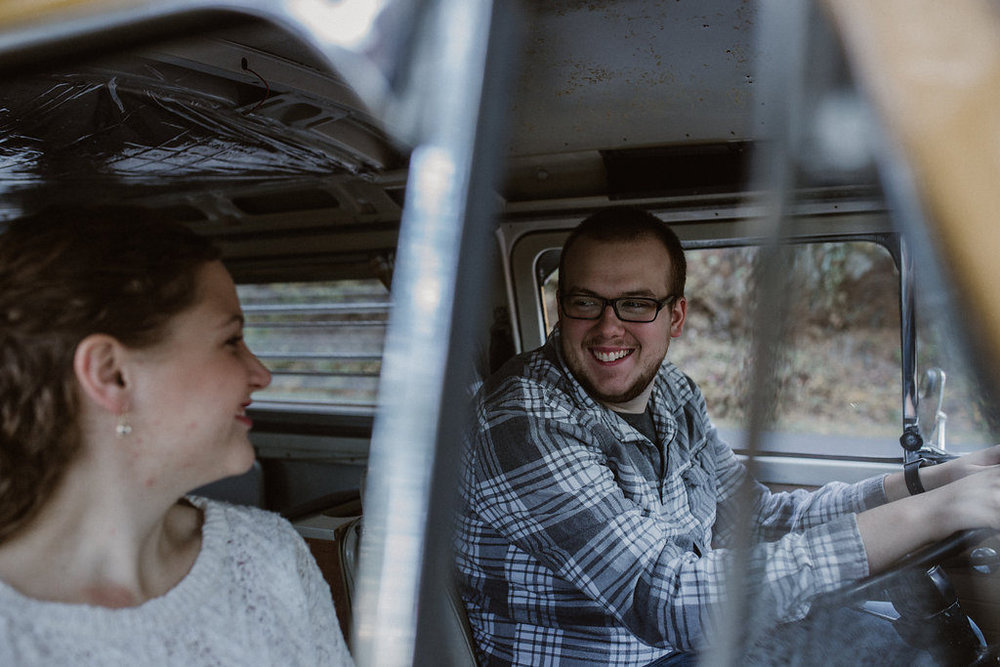 Couple driving in VW bus, engagement session with Tessa Blackstone