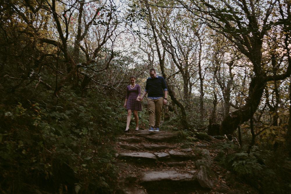 Couple walking through woodland setting, engagement session with Tessa Blackstone