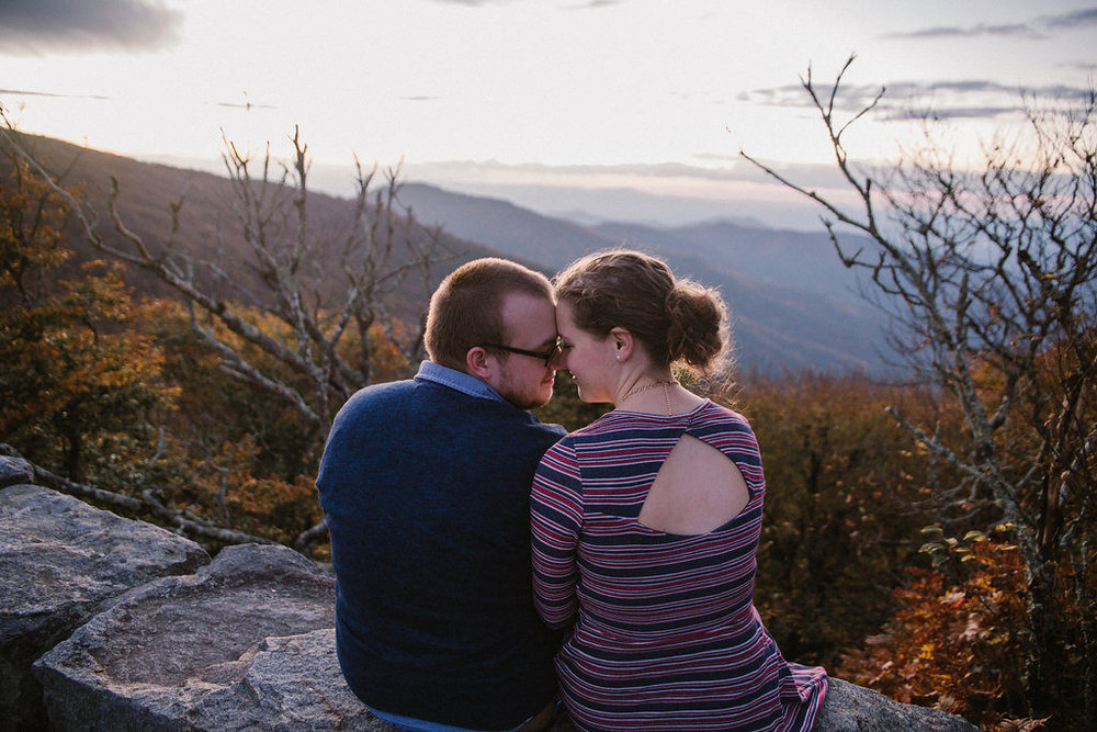 Couple kissing in NC mountains, engagement session with Tessa Blackstone