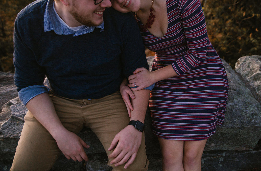 Couple smiling outside, engagement session with Tessa Blackstone