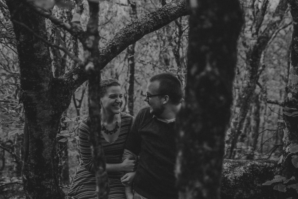 Black and white photo of couple laughing, engagement session with Tessa Blackstone