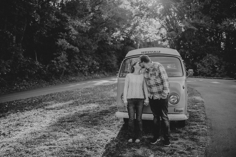 Black and white photo of couple kissing, engagement session with Tessa Blackstone