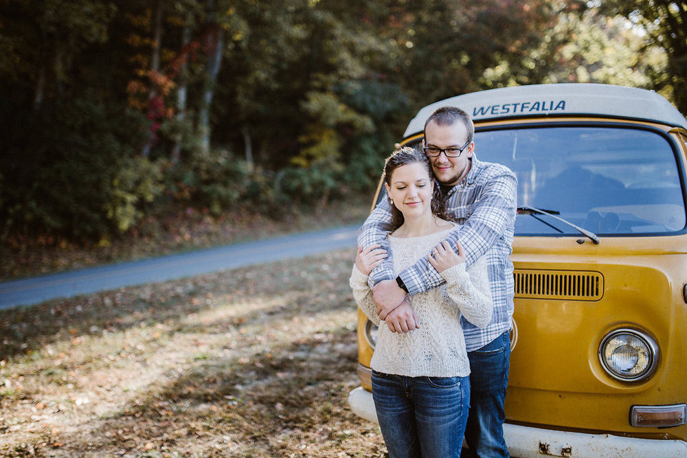 Couple hugging, engagement session with Tessa Blackstone