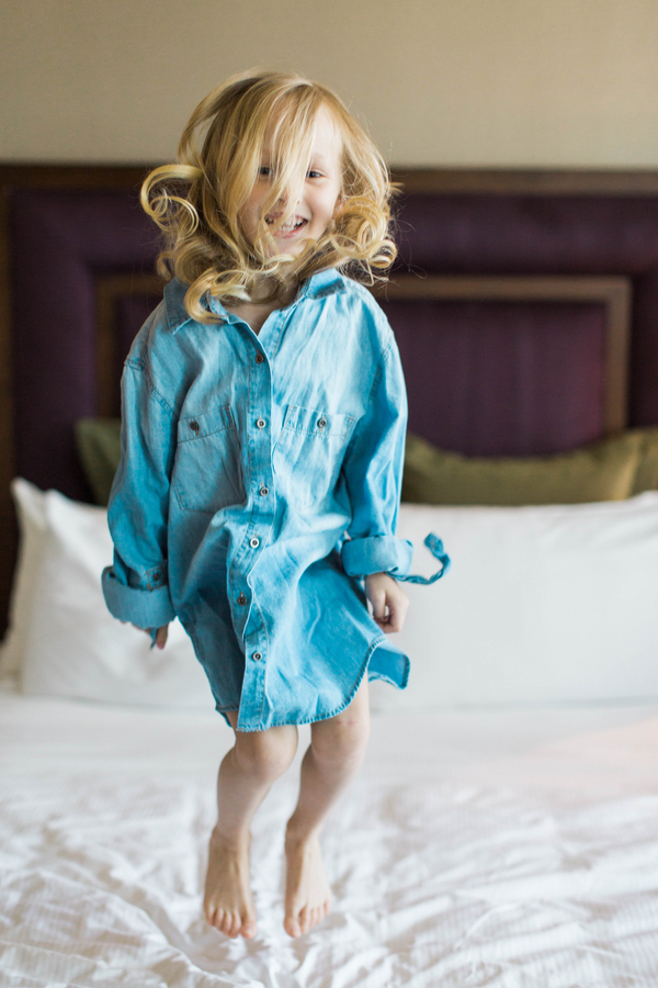 Ashley Giffin Photography Child Jumping on Bed