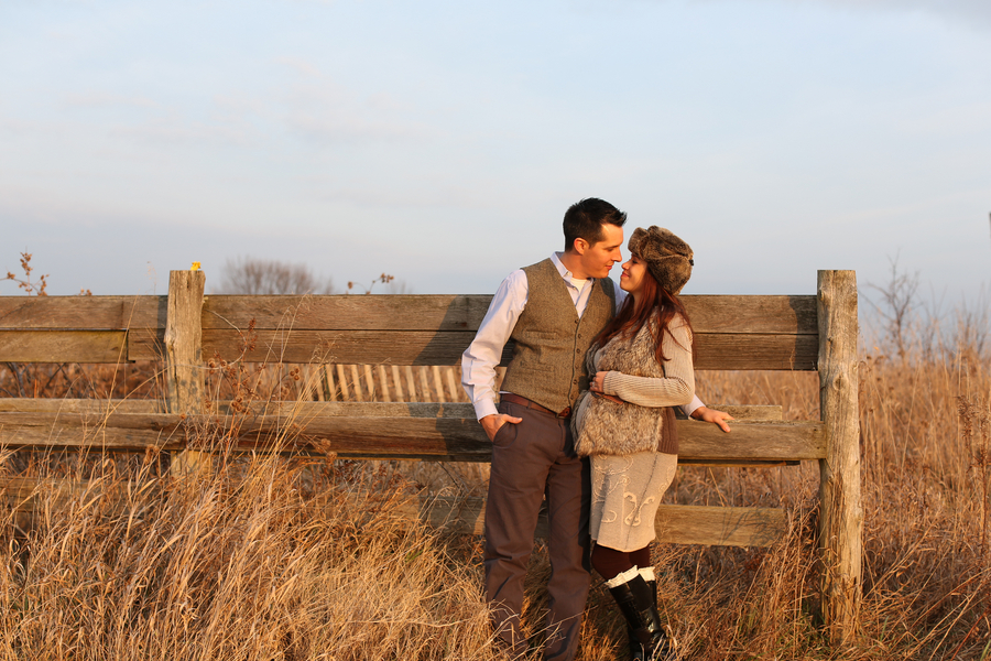 Couple smiling at each other, Countryside + Sunset Baby Bump Session | Turnquist Photography