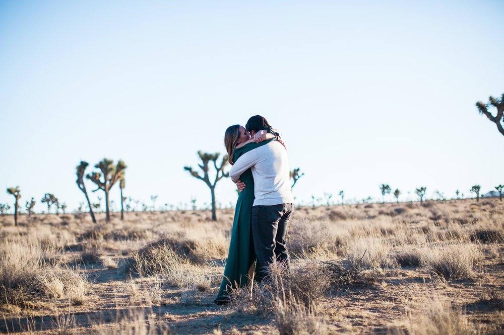 Couple hugging in desert, Joshua Tree Anniversary Session | Lindsey Parkin Photography
