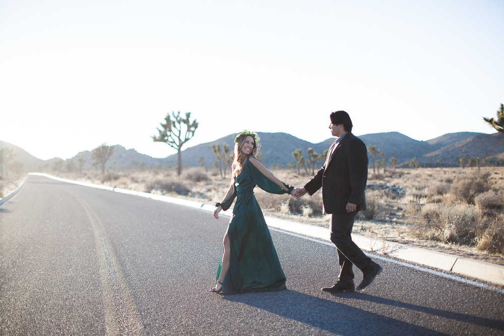 Couple walking across road, Joshua Tree Anniversary Session | Lindsey Parkin Photography