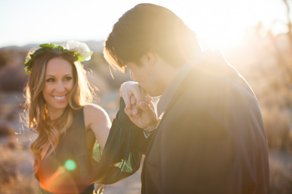 Husband kissing wife's hand, Joshua Tree Anniversary Session | Lindsey Parkin Photography
