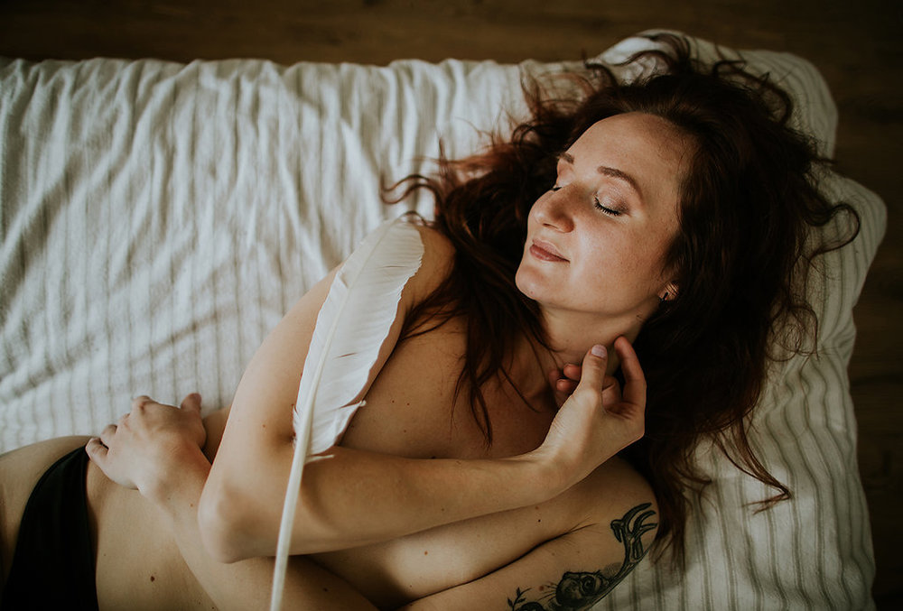 "Woman laying with feathers, Showing Herself: ""FOR HER"" Boudoir Session 