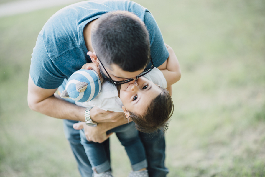 Dad kissing daughter, Outdoor + Dusk Family Portrait Session | Serena Genovese