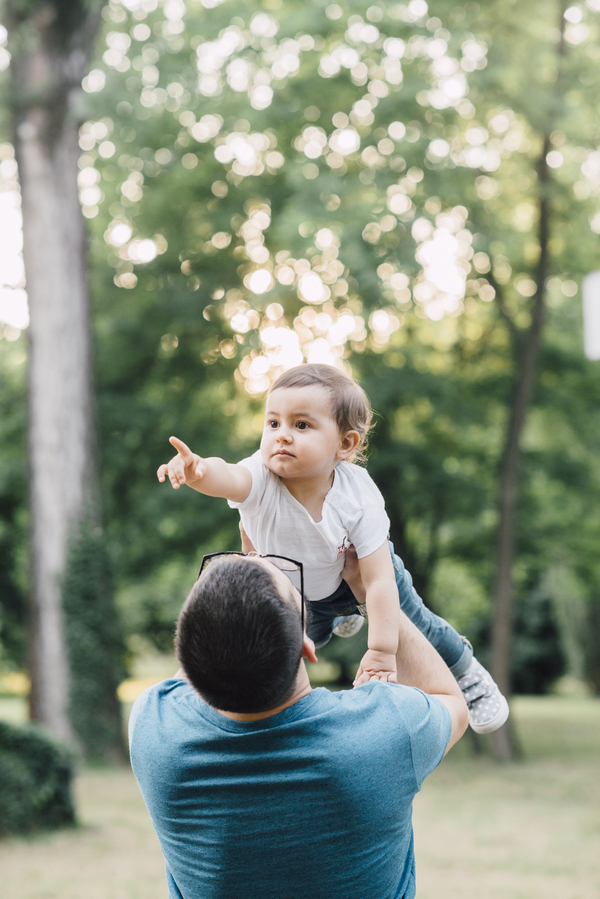 Daughter lifted in air, Outdoor + Dusk Family Portrait Session | Serena Genovese