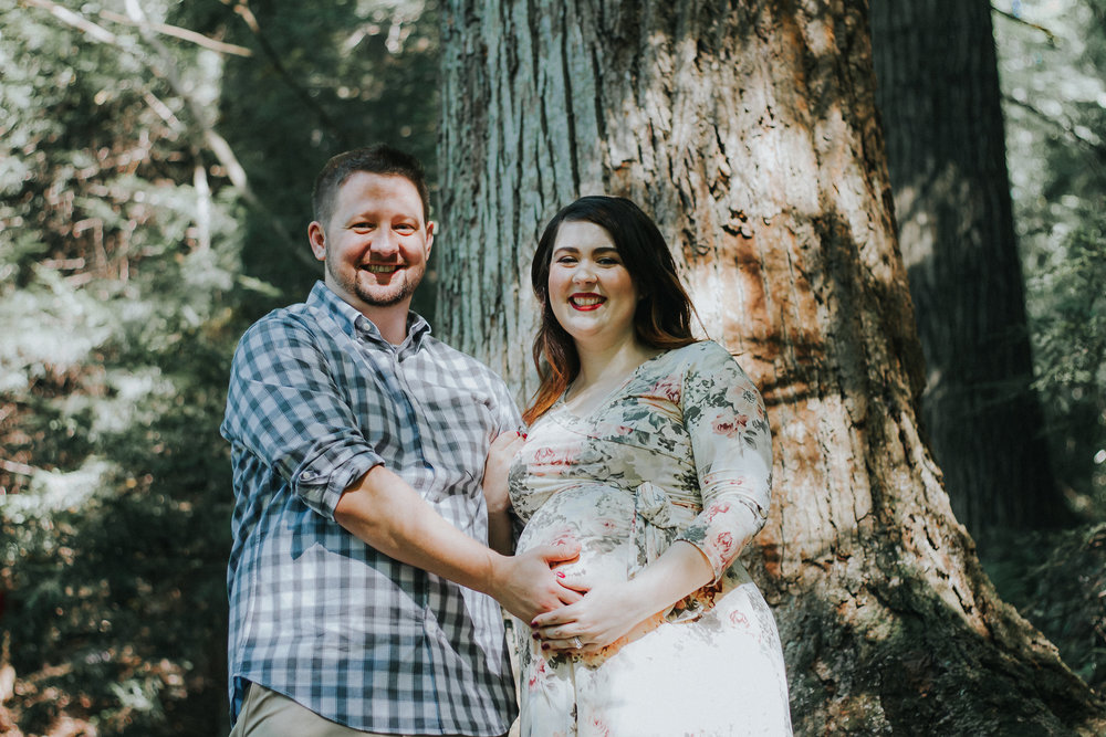 Couple holding pregnant belly, Artistic + Woodsy Maternity Session | Sarah P Thomas Photography
