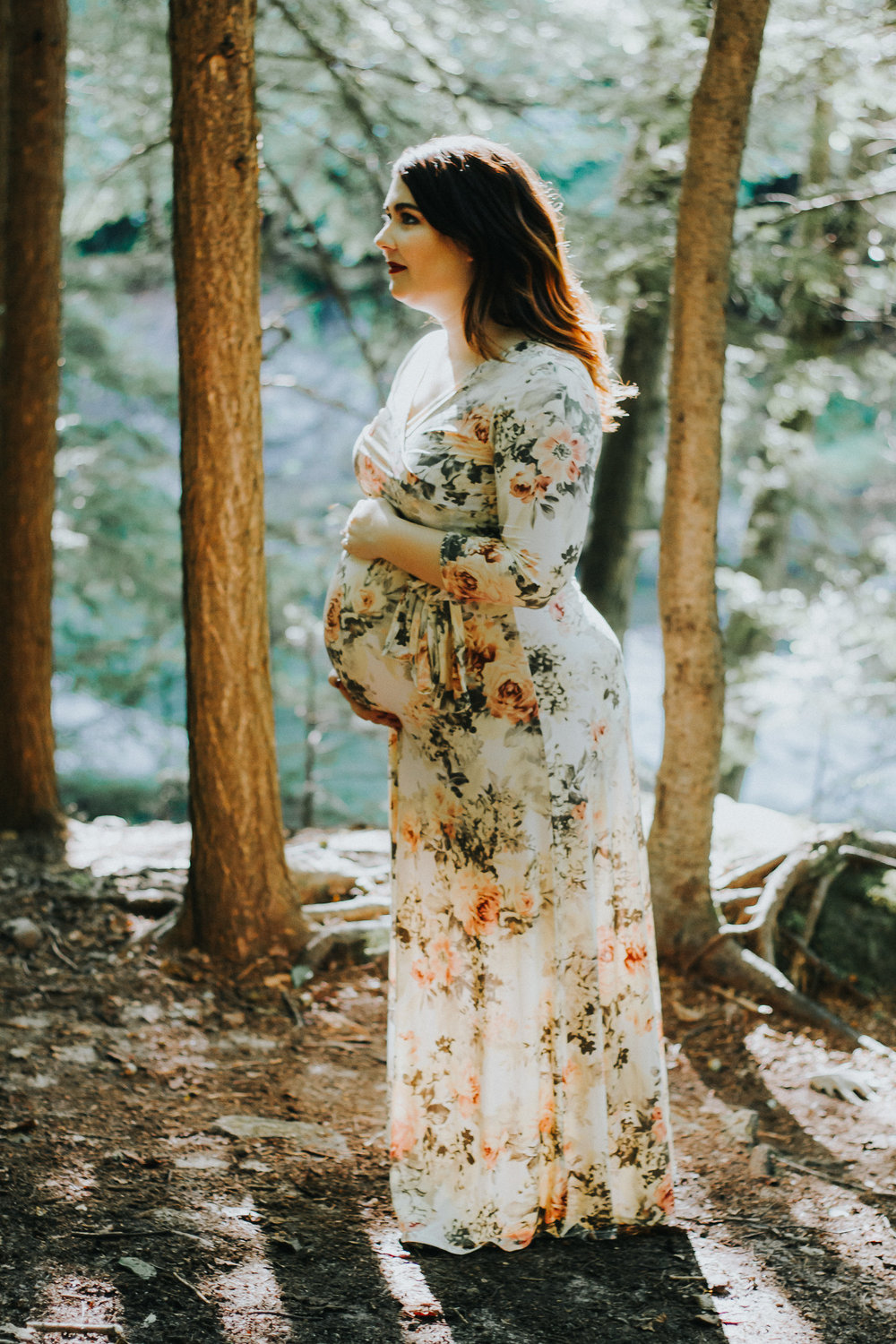 Mom to be holding pregnant belly, Artistic + Woodsy Maternity Session | Sarah P Thomas Photography