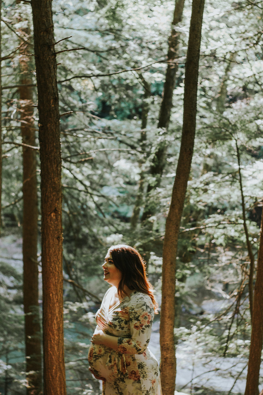 Mama to be holding belly in woods, Artistic + Woodsy Maternity Session | Sarah P Thomas Photography