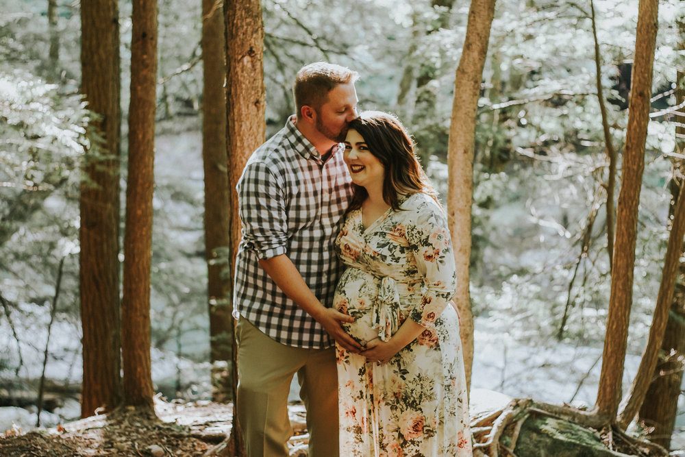 Father to be kissing mom to be, Artistic + Woodsy Maternity Session | Sarah P Thomas Photography