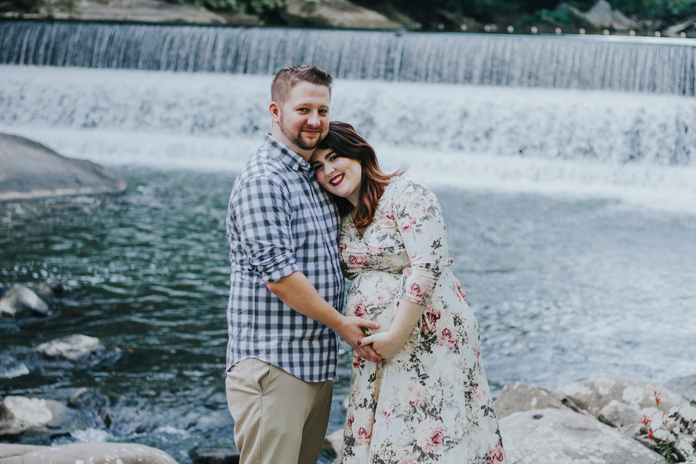 Couple in front of waterfall, Artistic + Woodsy Maternity Session | Sarah P Thomas Photography