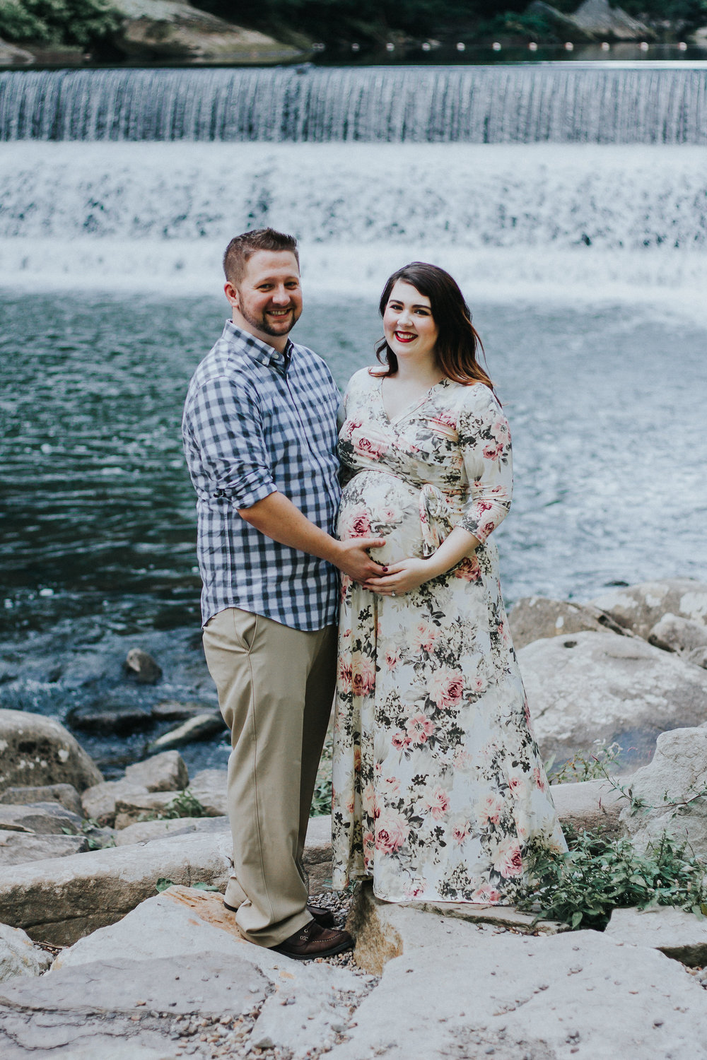 Couple smiling in front of waterfall, Artistic + Woodsy Maternity Session | Sarah P Thomas Photography