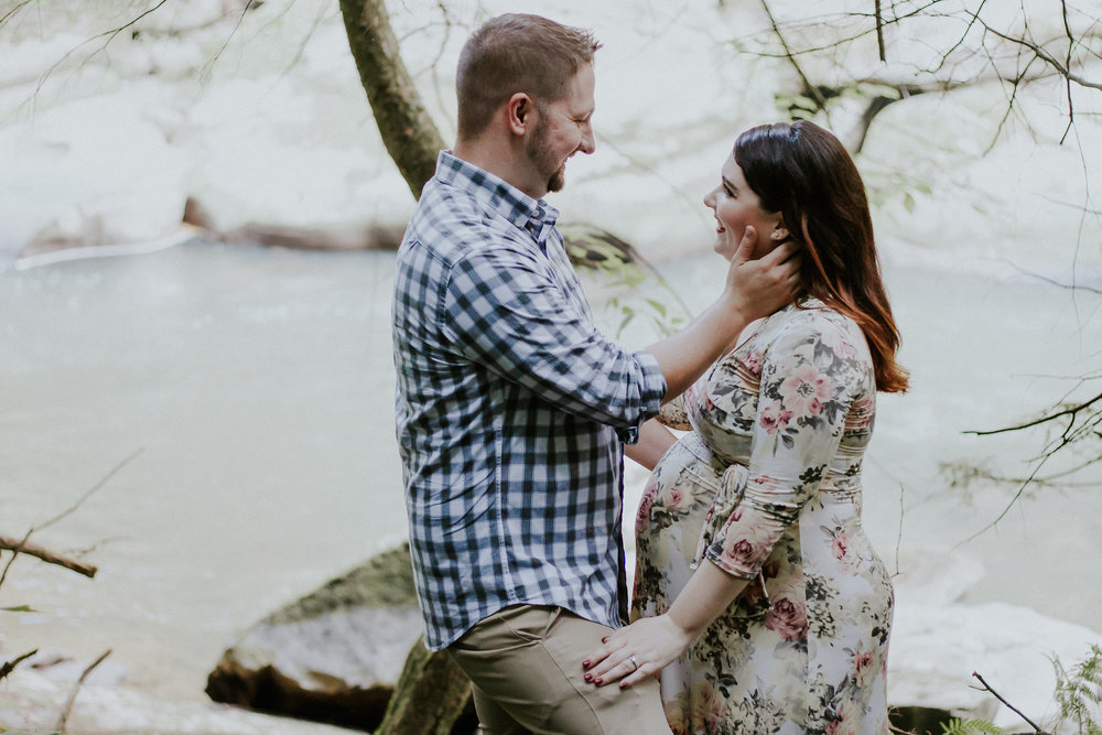 Couple smiling at each other, Artistic + Woodsy Maternity Session | Sarah P Thomas Photography