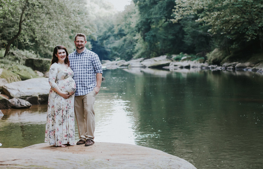 Photo of couple in front of lake, Artistic + Woodsy Maternity Session | Sarah P Thomas Photography