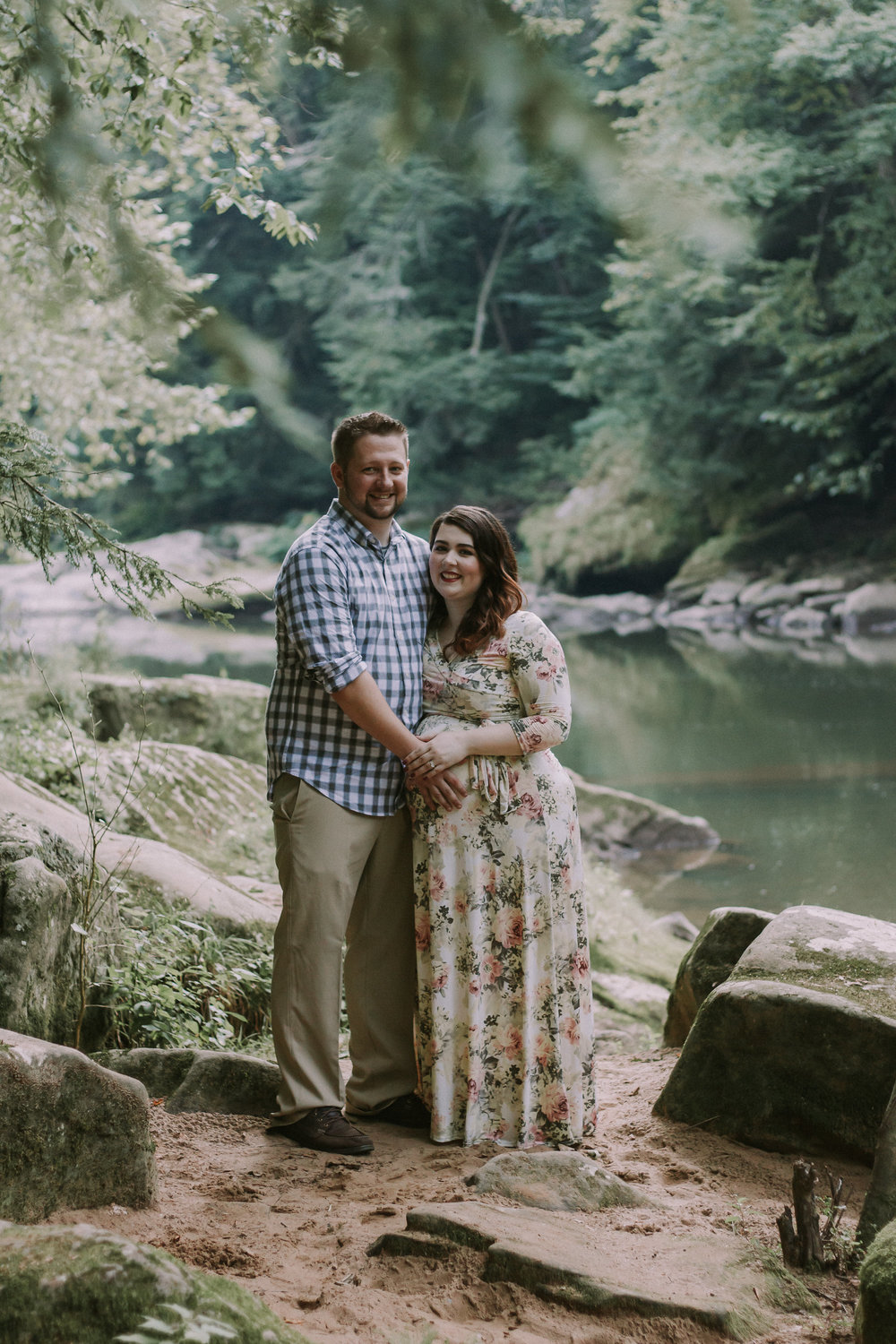 Photo of couple in woods, Artistic + Woodsy Maternity Session | Sarah P Thomas Photography