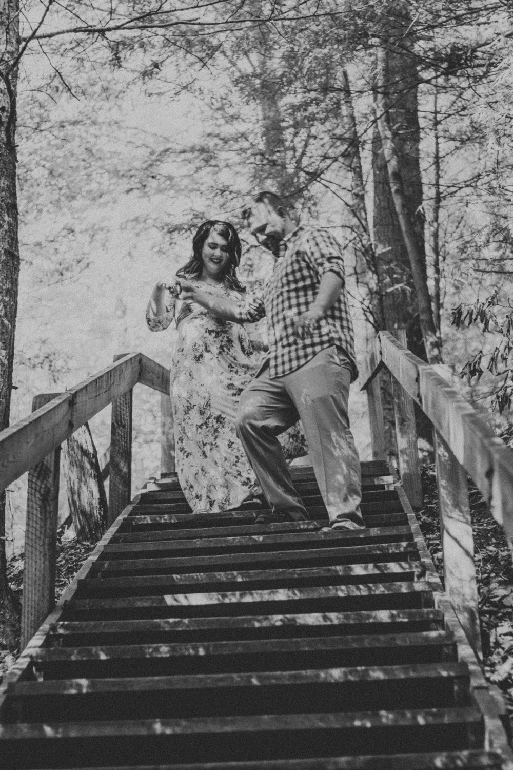 Black and white photo of couple walking down stairs, Artistic + Woodsy Maternity Session | Sarah P Thomas Photography
