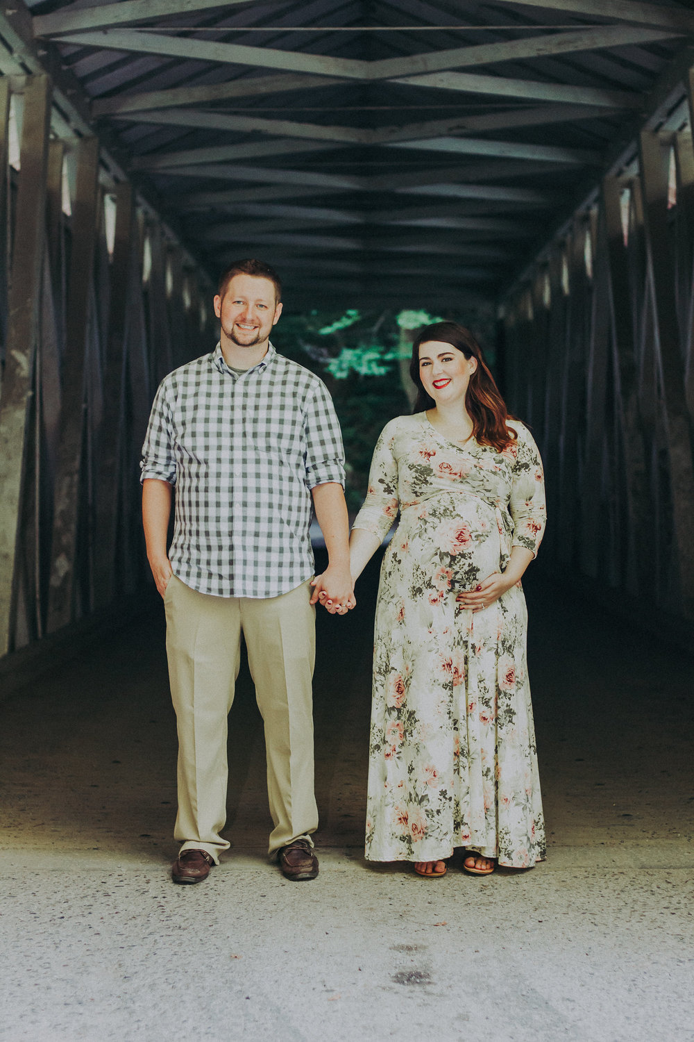 Couple posing in covered bridge, Artistic + Woodsy Maternity Session | Sarah P Thomas Photography