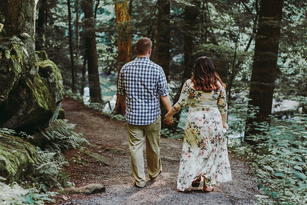 Couple walking away from camera, Artistic + Woodsy Maternity Session | Sarah P Thomas Photography