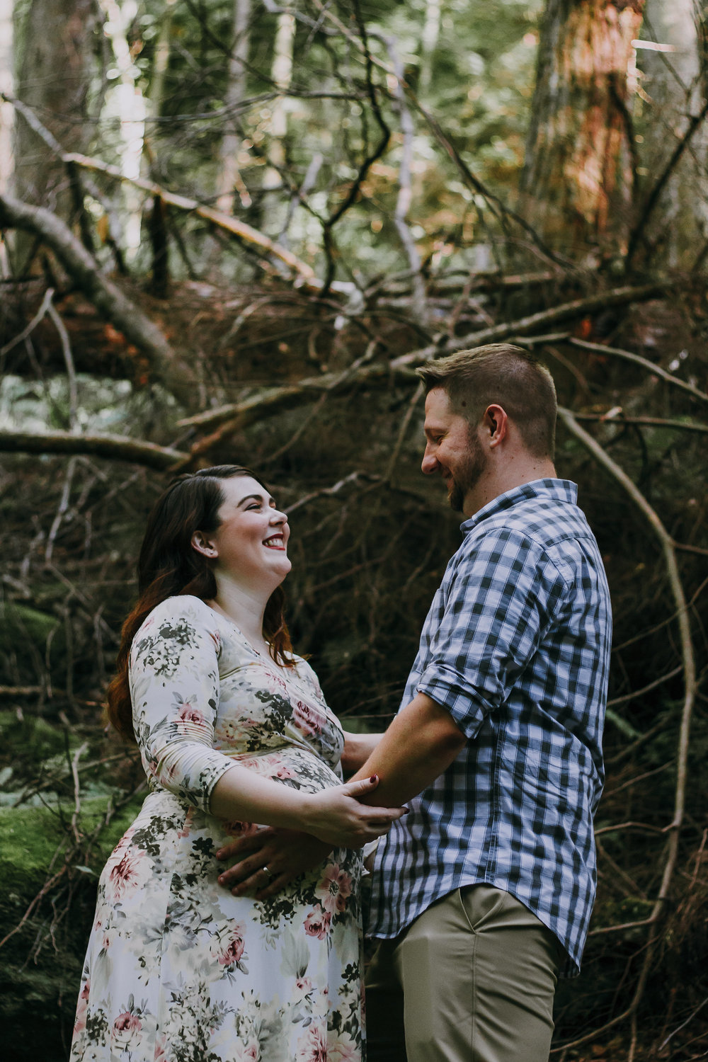 Couple looking at each other, Artistic + Woodsy Maternity Session | Sarah P Thomas Photography