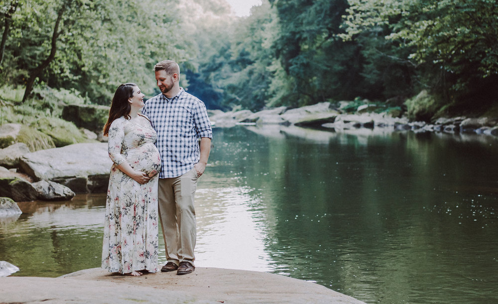 Pregnant couple posing by lake, Artistic + Woodsy Maternity Session | Sarah P Thomas Photography