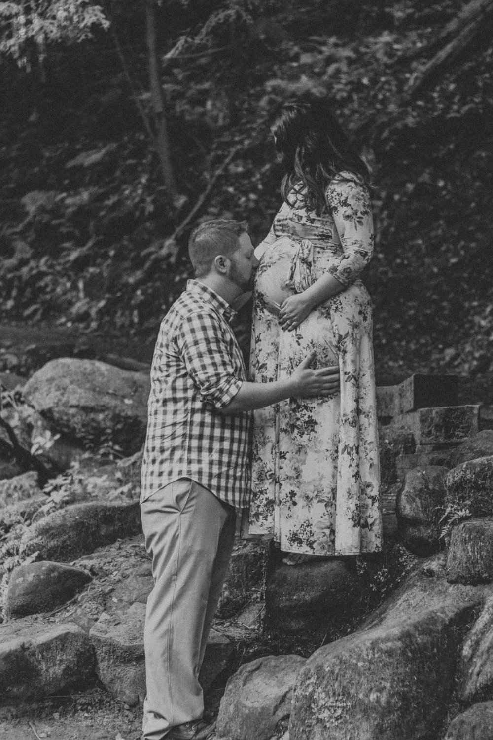 Black and white photo father to be kissing pregnant belly, Artistic + Woodsy Maternity Session | Sarah P Thomas Photography