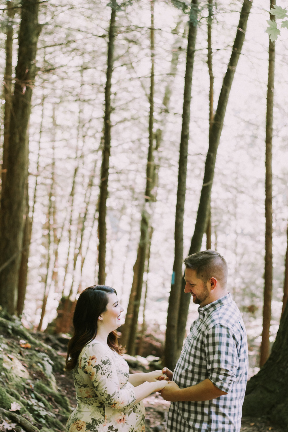 Couple holding hands in woods, Artistic + Woodsy Maternity Session | Sarah P Thomas Photography