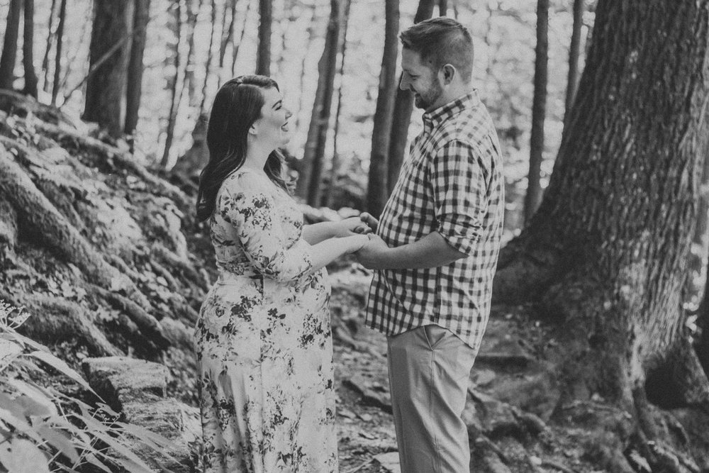 Black and white photo of couple holding hands, Artistic + Woodsy Maternity Session | Sarah P Thomas Photography