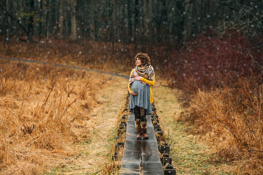 Mom to be on path in woods, Foggy Field Morning Baby Bump Session | Turnquist Photography