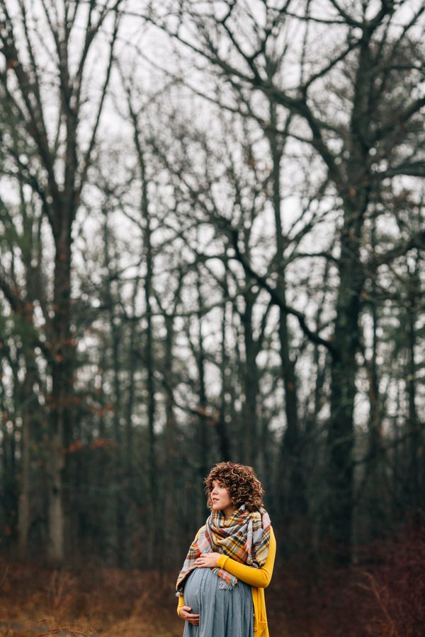 Pregnant mom holding belly among trees, Foggy Field Morning Baby Bump Session | Turnquist Photography