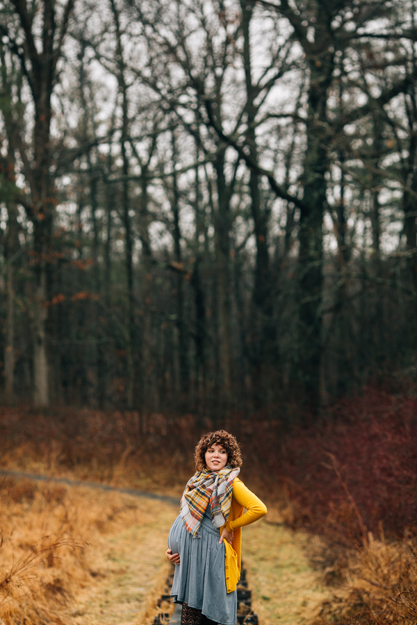 Mom to be posing among trees, Foggy Field Morning Baby Bump Session | Turnquist Photography