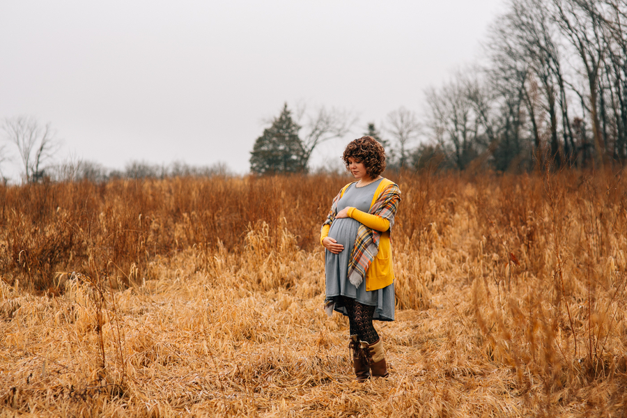 Pregnant woman holding belly in field, Foggy Field Morning Baby Bump Session | Turnquist Photography