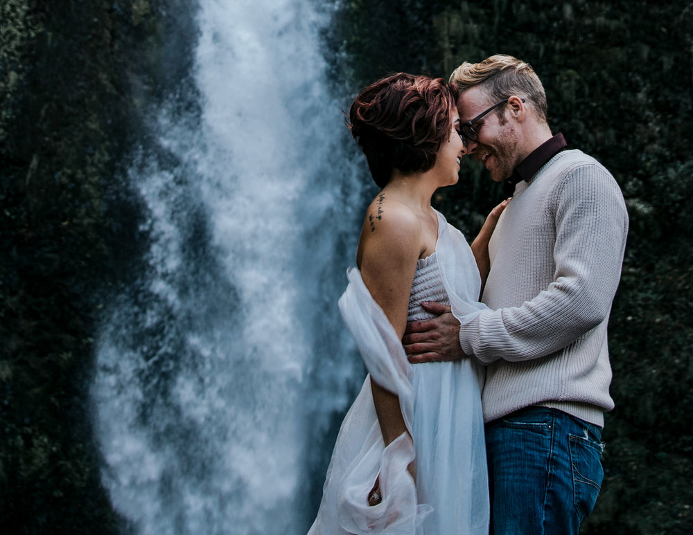 Couple hugging in front of waterfall, Adventurous Outdoor + Waterfall Couples Session | Croative Photography