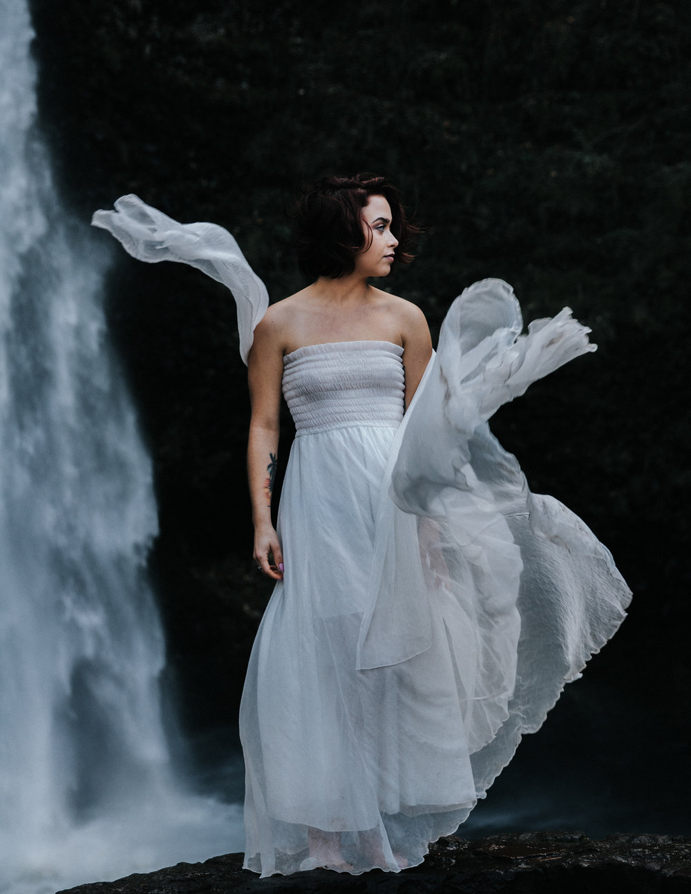 Woman in flowy white dress by waterfall, Adventurous Outdoor + Waterfall Couples Session | Croative Photography