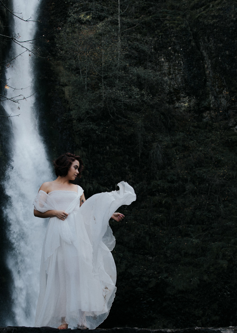 Woman dancing in white dress in woods, Adventurous Outdoor + Waterfall Couples Session | Croative Photography