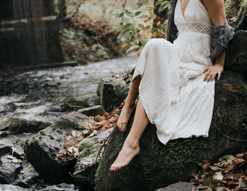 Woman in white dress sitting on rock, Adventurous Outdoor + Waterfall Couples Session | Croative Photography