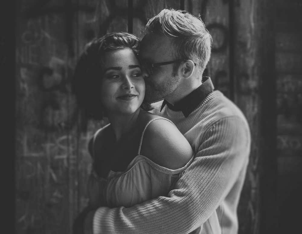 Black and white photo of fiance kissing girlfriend on cheek, Adventurous Outdoor + Waterfall Couples Session | Croative Photography