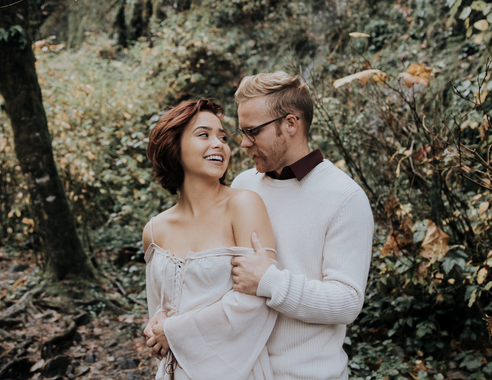Engaged couple looking at each other, Adventurous Outdoor + Waterfall Couples Session | Croative Photography