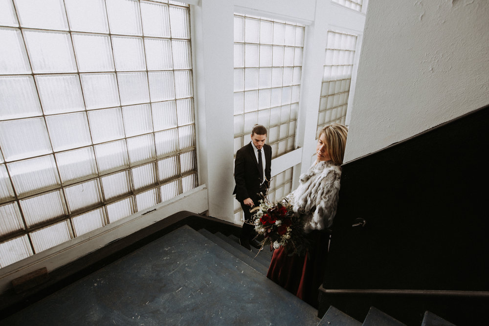 Bride and groom in stairwell, Friday the 13th Intimate Wedding | Brandy Swartz Photography