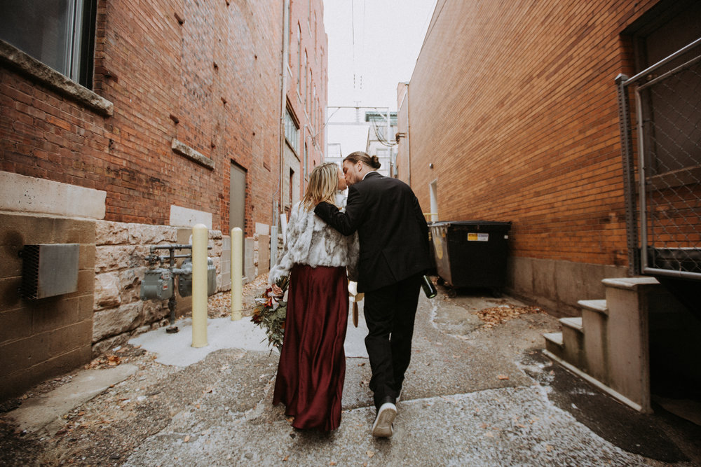 Bride and groom kissing in alley, Friday the 13th Intimate Wedding | Brandy Swartz Photography