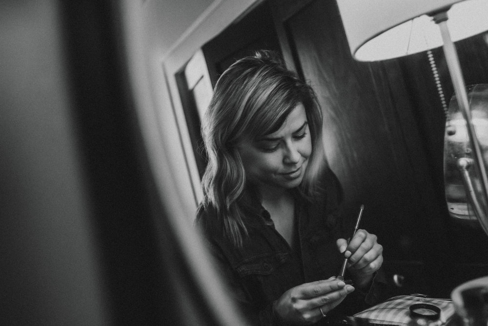 Bride putting on makeup, Friday the 13th Intimate Wedding | Brandy Swartz Photography