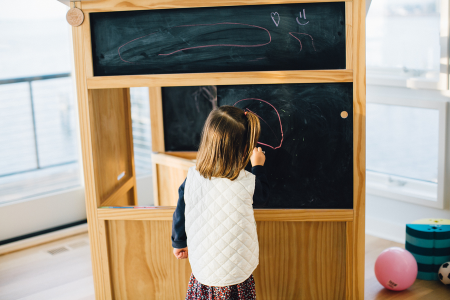 Daughter writing on chalkboard, Family Lifestyle Session on the Bay | Tiffany Caldwell Photography