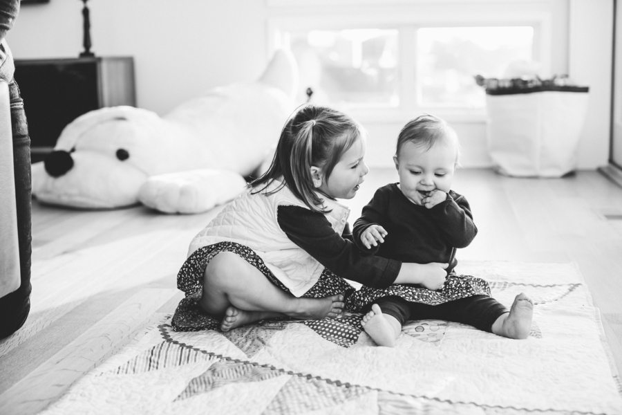 Black and white photo of sisters, Family Lifestyle Session on the Bay | Tiffany Caldwell Photography