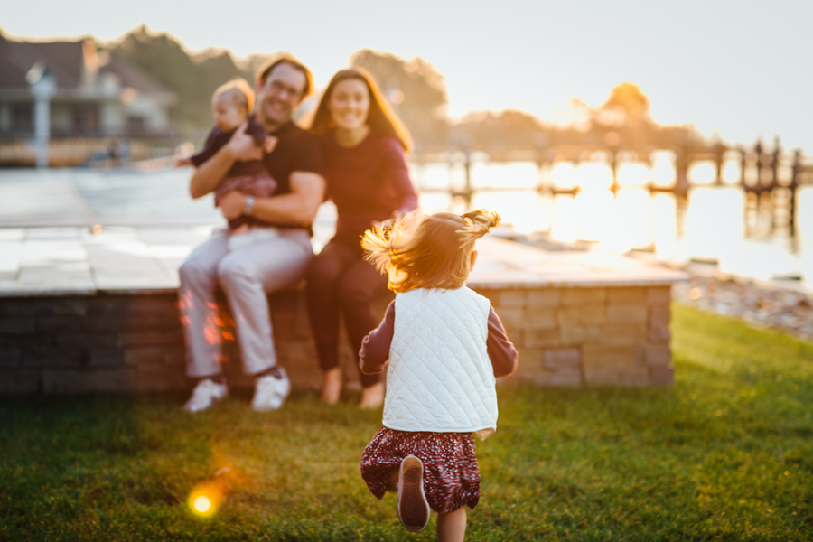 Girl running towards family, Family Lifestyle Session on the Bay | Tiffany Caldwell Photography
