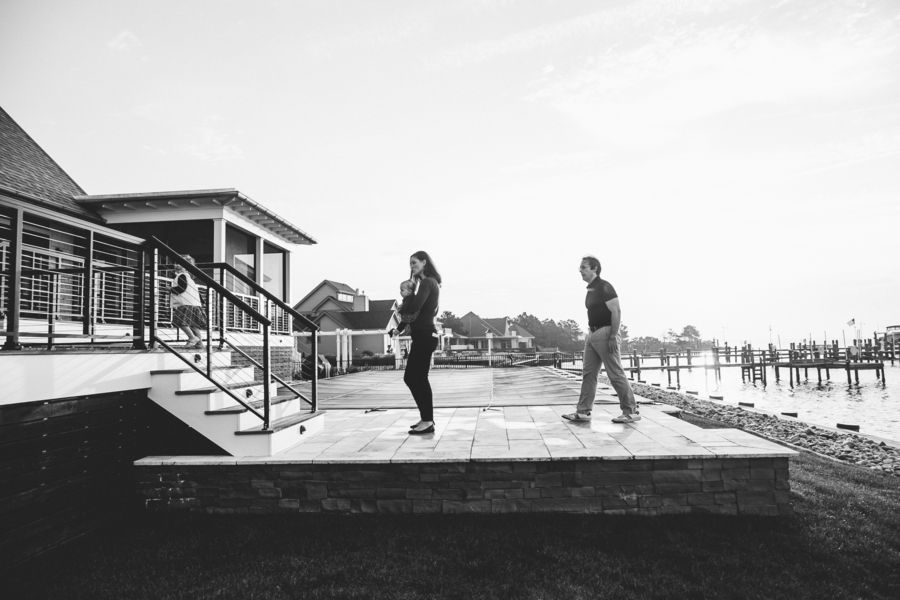 Black and white photo of family walking towards building, Family Lifestyle Session on the Bay | Tiffany Caldwell Photography