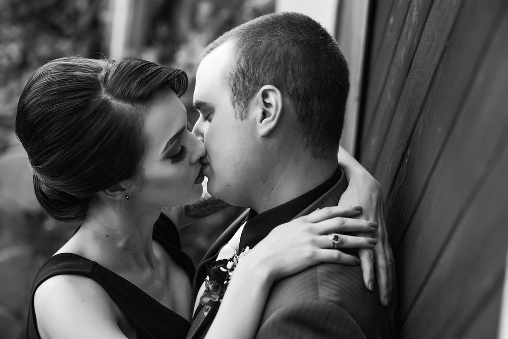 Black and white photo of couple kissing, The Why Behind My Photography | Blossom and Bloom Photography